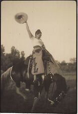 ORIGINAL c1950s PHOTOGRAPH COWGIRL RIDING A BUCKING BRONCO HORSE STIRRUPS CHAPS