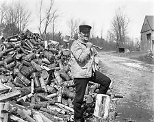 Early 1900s George Slade glass neg. Man with axe and formidable wood pile