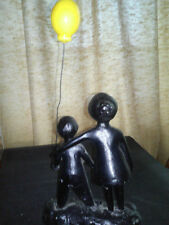 VINTAGE  LITTLE BOY AND MOTHER WITH BALLOON CAST IRON DOORSTOP SOLID HEAVY