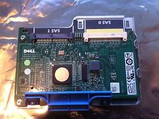 Dell NP007 UCS-61 PCI SAS 6/iR RAID Controller Card with cradle.