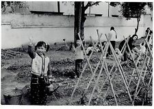1973 Vintage Photo young children perform labor by tending garden Canton China