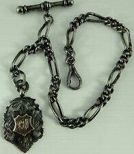 Antique white metal albert chain with silver and gold fob medal