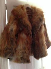 Cappotto volpe pelliccia. rosso e dorato.