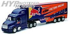 NEW RAY 1:32 PETERBILT 387 RED BULL KTM RACING TRUCK DIECAST BLUE 10693