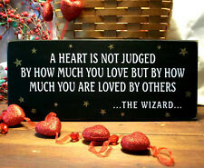 Wizard of Oz A Heart is Not Judged Primitive Wood Sign Black Plaque Wall Decor