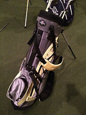 "US Kids 34"" stand bag in black and yellow. 33"" putter, 41"" 3 wood."