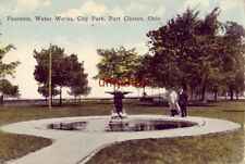 FOUNTAIN WATER WORKS, CITY PARK, PORT CLINTON, OH couple stands next to fountain