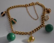 BW71     14k YELLOW  GOLD  VINTAGE  CHARM  BRACELET WITH  7 BEAD CHARMS.