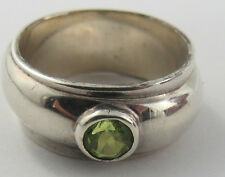 R-11 SIZE 7 3/4 LDS 925 PERIDOT SOLITAIRE RING. WEIGHS 8.80 GRAMS. SEE PICTURES.