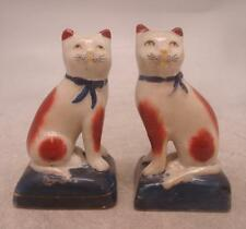 Staffordshire Pottery Pair of Figures - Seated Cats with Ribbon Collars