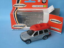 Matchbox Jeep Grand Cherokee Silver Body with Boat Toy Model Car Boxed