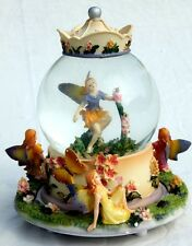 Dancing fairies musical snow globe plays Greensleeves