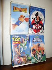 4 Walt Disney Clam Shell VHS Tapes -101 Dalmatians/Air Bud/Toy Story/Angels Outf