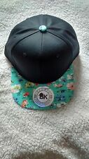 COTTON FLAT BILL FLORAL SNAPBACK HAT- FRONT BLACK AND BRIM FLOWER TURQUOISE