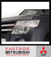 NEW GENUINE MITSUBISHI NS NW NX PAJERO HEADLIGHT HEADLAMP PROTECTOR SET MR935185