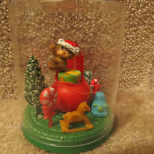 Solar Santa Bear Swinging over Presents