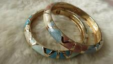 Vintage Pair of Goldtone Enameled Aztec Pattern Sprung Clamper Bangles