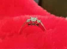 Princess cut 3 stone diamond ring