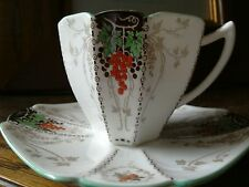 A SHELLEY TALL QUEEN ANNE COFFEE CUP & SAUCER BUNCHES OF GRAPES IN BLACK & RED C