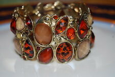 WONDERFUL RUNWAY GOLD TONED METAL AND BROWN ACRYLIC STONES STRETCH CUFF BRACELET