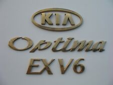 2003 KIA OPTIMA EX V6 REAR GOLD EMBLEM LOGO BADGE SIGN SYMBOL OEM 01 02 03 04 05