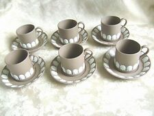 SIX WEDGWOOD TAUPE BROWN JASPERWARE DEMITASSE CUPS & SAUCERS WITH SHELL MOTIF