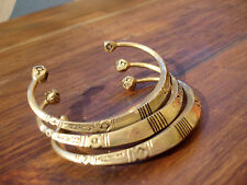Niger Tuareg shiny gold colour chunky bracelet with stripes and geometric ends