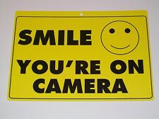 Security Surveillance CCTV Cameras Smile You're On Camera Yellow Warning Sign