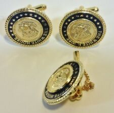 White House eagle cufflinks set with matching tie pin.