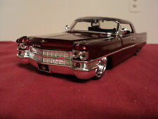 Jada 1963 Cadillac series 62 1/24 scale new  2010 release candy red  exterior