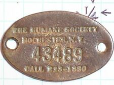 CANINE DOG TAG THE HUMANE SOCIETY ROCHESTER N.Y. 43489 CALL 223 1330 COPPER OVAL