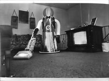 Vintage photo of A domestic android robot made by Quasar Industries, is here see