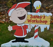 Charlie Brown found Sant's Workshop at Christmas in the north pole lawn stake
