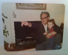 Vintage 70s PHOTO LITTLE GIRL IN OVERALLS FUNNY BABY TEETH W/ GRANDPA FIREPLACE