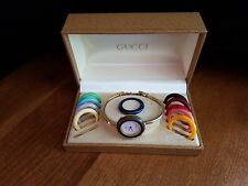 GUCCI 1100-L INTERCHANGEABLE BEZEL BANGLE STYLE LADIES WRIST WATCH w/ 11 BEZELS.