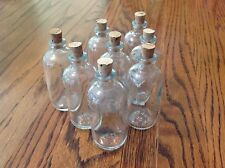 Lot of 8 60 mils clear glass vials/bottles T C W Co. with cork stoppers