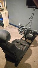STEERING WHEEL LOGITECH G29 with the frame and a seat