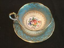 AYNSLEY CHINA TEAL BLUE AND GOLD ROSES FLORAL TEA CUP AND SAUCER