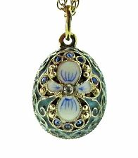 Russian silver and 24 ct gold-plated flower egg pendant with dark green enamel