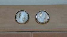 VINTAGE GOLD TONE AND WHITE CUFFLINKS ROUND WITH A DESIGN ON THEM
