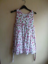 Girls Dress,Luli Clothing,Sleeveless.White background with floral pattern. Age 5