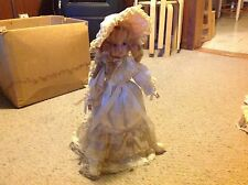 """Baby Doll with Porcelain ? Face, feet and hands.     17""""  long.  Used.  With Sta"""