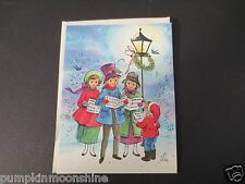 Unused Vintage Glitter Xmas Greeting Card Holiday Carolers Singing Under Light