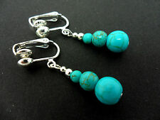 A PAIR OF TURQUOISE BLUE  SILVER PLATED DANGLY CLIP ON  EARRINGS. NEW.