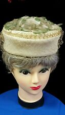 cream-colored vintage ladies hat netting flowers pill box