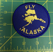 Fly Alaska Embroidered patch with Bush Plane inside state, unique collectible