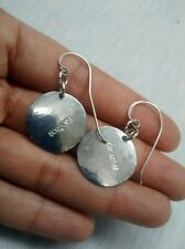 Pretty Rebecca Norman  disc wire   earrings