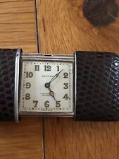 A beautiful antique Solid silver Movado Ermeto Chronometer ladies purse watch