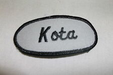 KOTA  USED EMBROIDERED VINTAGE SEW ON NAME PATCH TAG OVAL BLACK ON GREY