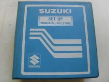 USED GENUINE SUZUKI 1983 DEALER BINDER WITH 43 SET UP & PREPARATION MANUALS